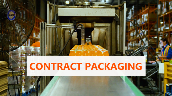 Shrink wrapped carton of orange drink bottles on packaging line in a warehouse