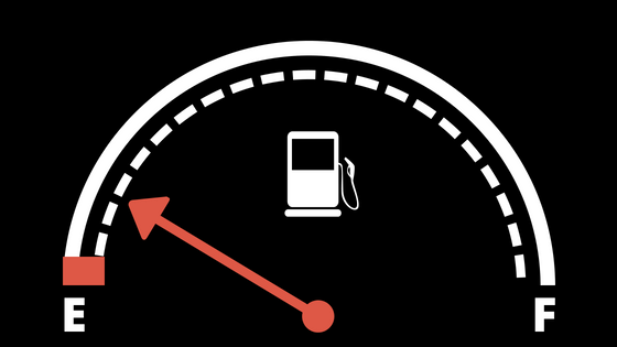 Fuel gauge with orange arrow nearly pointing to empty