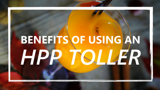 Glass of orange juice with text- Benefits Of Using An HPP Toller