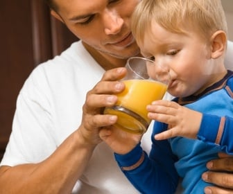 Child drinking juice, High Pressure Processing helps with food safety