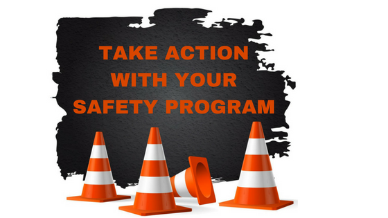 Orange and white striped construction cones with text- Take Action with Your Safety Program