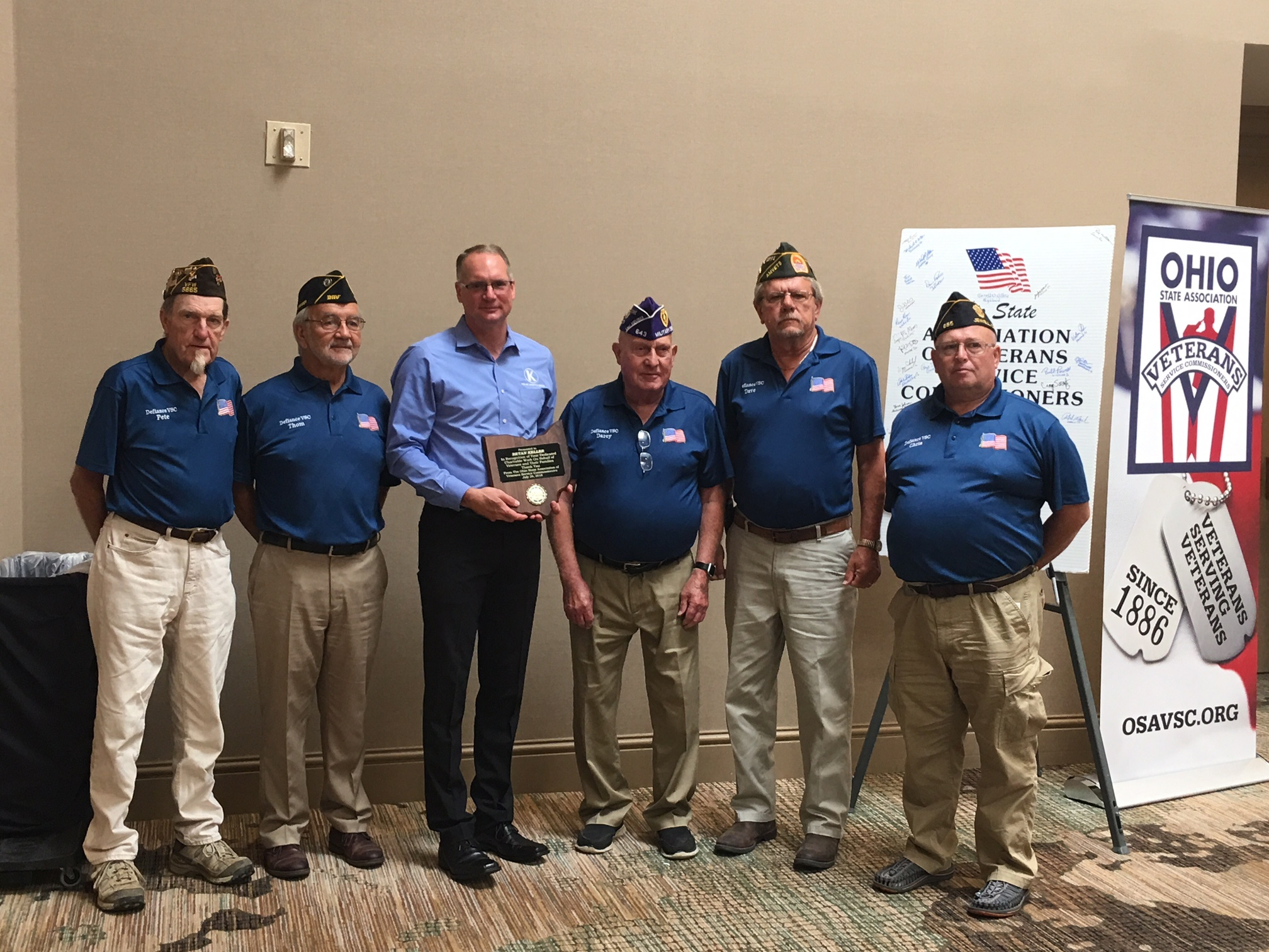Bryan Keller pictured with Ohio State Veterans Service Commissioners: Peter Kenner, Thomas Kent, Darcy Lehman, Dave Lulfs, Chris Newton - receiving award