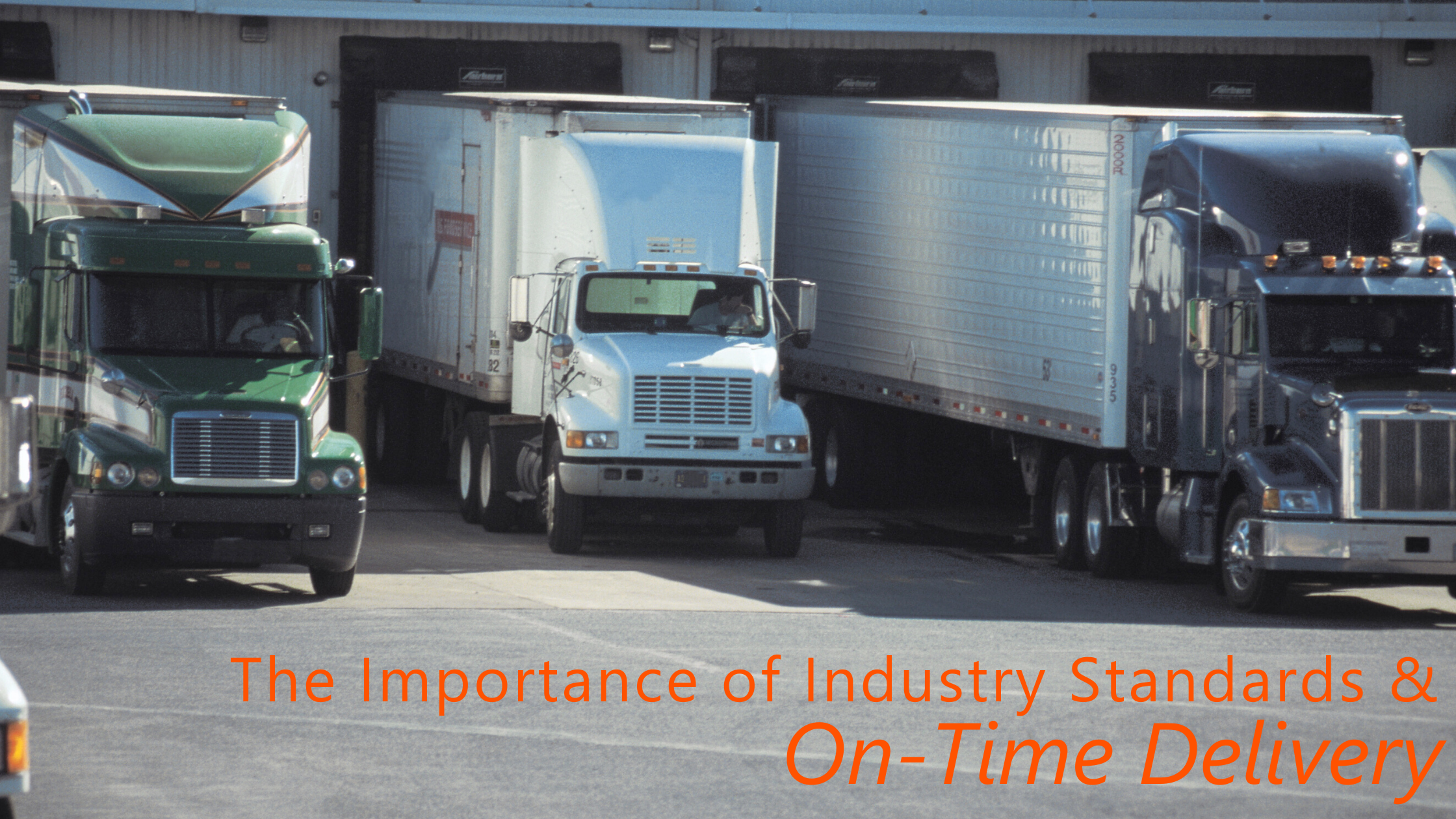 The-Importance-of-Industry-Standards-and-On-Time-Delivery-Semi-Trucks-Backed-into-Warehouse-Docks